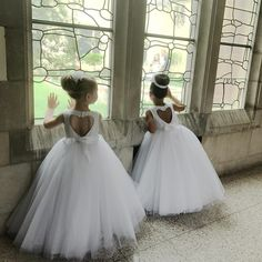 Our hearts can't handle it! Shop this sweet ball gown flower girl dress from David's Bridal   Photo by Liz Knutson; Instagram/@lizknuty