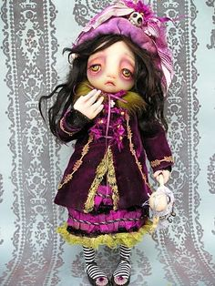 I found this searching purple velvet. I think everything about this doll is amazing. http://gaillackey.blogspot.com/2010/05/new-ghostie-ebay-listing.html