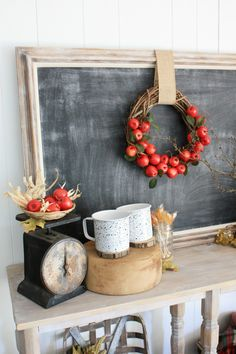 Set up a hot apple cider bar and allow friends to enjoy a customized fall drink. Apple Cider Bar with Cinnamon Sticks, apples and of course cute fall apple decor like this DIY Apple Wreath.