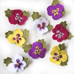 Pansy brooches hand embroidered felt pansy brooch available in purple white yellow and fuchsia pink floral gift viola flowersPansies are such adorable flowers, I couldnt resist making these little felt brooch versions! My pansy brooches are available Felt Applique, Crewel Embroidery, Embroidery Patterns, Hungarian Embroidery, Embroidery Hoops, Embroidery Jewelry, Felt Diy, Felt Crafts, Fabric Crafts