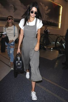 Kendall.. Topshop Roll Back Crop Tee, Forever 21 pleated wide leg overalls, Kenneth Cole Kam Sneakers, and Givenchy Lucrezia Bag..