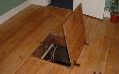 This secret trap door in a wood floor allows access to the home's basement/crawlspace. Secret Storage, Hidden Storage, Extra Storage, Passage Secret, Hatch Door, Trap Door, Bomb Shelter, Survival Shelter, Secret Rooms