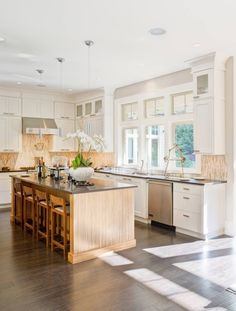 This kitchen looks HUGE with all of this awesome natural light!