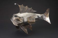 stainless steel fish..this guy makes some cool shtuff...pearsonmetalart.com