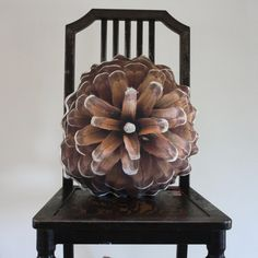 Perk up a plain chair with a photorealistic pine cone–printed pillow. #etsy