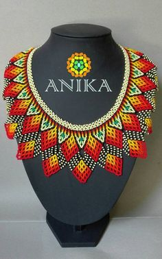 Handicraft Embera Necklace Beautiful handicraft Necklace by Embera natives from Colombia. They used czech blends, thread and their imagination. Pony Bead Patterns, Bead Crochet Patterns, Beaded Jewelry Patterns, Beading Patterns, African Necklace, African Jewelry, Crochet Earrings Pattern, African Accessories, Pony Beads