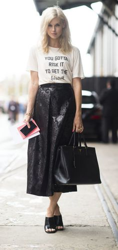 A shimmering black skirt, a graphic t-shirt, and a classic leather tote.
