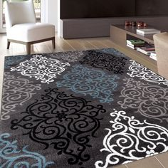 This gorgeous contemporary and casual rug is a dream for interior decorators, and showcases lovely rich colors like white, black and grey.