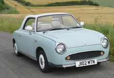 weekend car - nissan figaro - a teeny little car to tool around.