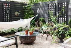 Inside This One Kings Lane Editor's Inspiring Backyard Makeover: One Kings Lane editor Megan Pflug gives us a glimpse into her stylish and Summer-read., Inside This One Kings Lane Editor's Inspiring Backyard Makeover Outdoor Rooms, Outdoor Gardens, Outdoor Living, Outdoor Decor, Garden Makeover, Backyard Makeover, Gravel Patio, Patio Fence, Backyard Privacy