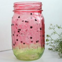 Turn a mason jar into a watermelon themed centerpiece for your next party with this super simple tutorial.