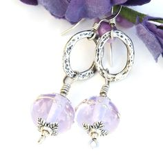 "Glowing, one of a kind ""Luscious in Lavender"" handmade earrings created with lavender color shift lampwork glass beads with fine silver dots, hammered sterling silver ovals, pewter bead caps and sterling silver."