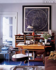 A vintage celestial chart from Rand McNally depicting the constellations for the Northern Skies is the focal point in the study of designer Thomas O'Brien's Manhattan apartment. The Miro table lamp with a blue base is by O'Brien for Visual Comfort, and the desk and tubular chrome armchair are vintage pieces from Aero, the decorator's home-furnishings shop in New York City.