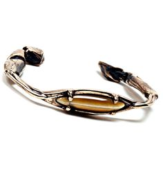 Crab Claw Cuff with Bronze with Cat's Eye. Available at www.catbirdnyc.com.