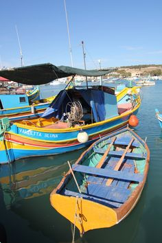 """On Mia's adventure in Malta, she reluctantly takes a boat ride from a stranger across the harbour on a boat similar to this one.  Quote from the boat's owner:  """"No worry madam,"""" he said pushing away from the dock. """"We fall out, you not pay."""""""