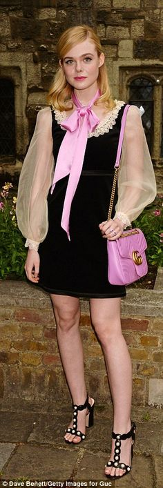 Pink accents: The blonde added fuchsia accessories to her look