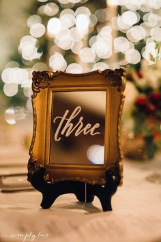Taking table numbers to the next level! Lovelettering hand-write these calligraphy letters on old gilded mirrors for table numbers. For a vintage 1920s themed wedding, this bride chose jewel tones with gold accents. Photography: Simply Lace Photography. Wedding Planner: Rebecca Chan Wedding