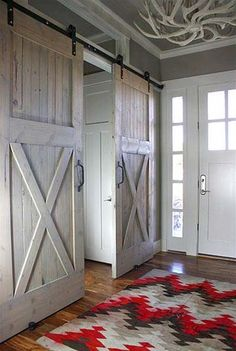 I love the antler light and the rustic sliding doors