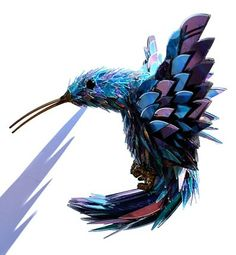 Hummm.......Creations of Sean Avery – Shattered CD Animals.Made out of used CD's and DVD's