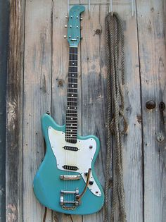 This is not Fender Maverick - Harvester Guitar Works Turquoise.