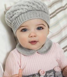 This might be the prettiest little baby ever! I love the hat!