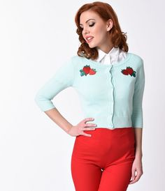 The appeal is real, gals! The perfect cover-up for cooler spring days, the Lucy strawberry cardigan from Collectif is a cotton knit mint 1950s separate with sleek quarter sleeves, darling pearlescent buttons and too-cute strawberry embroidery. Thick, ribb