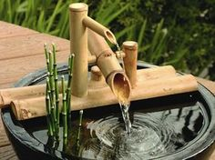 """Bamboo Rocking Fountain Kit Set this popular Bamboo Rocking Fountain on the edge of a bowl or small water basin. This fountain is a smaller version of a deer chaser or """"shishi odoshi"""" that was…More Indoor Waterfall Fountain, Bamboo Water Fountain, Water Fountain Design, Garden Water Fountains, Water Garden, Indoor Fountain, Japanese Garden Plants, Japanese Garden Design, Bamboo Garden"""