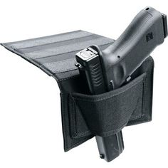 Blackhawk!® Bedside Holster – Ambidextrous at Cabela's.  Neat idea if we didn't have a young child in the house.