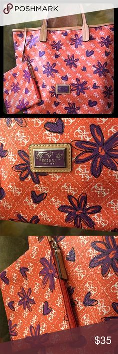 """GUESS XL TOTE """"KISS ME"""" PURPLE & ORANGE ~NEW✳️ This is a brand new with no tags (never used) 〰MINT CONDITION‼️ GUESS XL TOTE """"KISS ME"""" Carry All in ORANGE & PURPLE. The trim and straps are leather and the purse is made of the PVC Material (faux leather) inside the tote is a attached Wristlet too. Snap closure ✳️. This is a very large tote almost a weekend travel size bag. This is kind of why I bought it too! MEASUREMENTS: Length17"""" Height13"""" Depth10"""" Strap drop20""""  feel free to ask any…"""