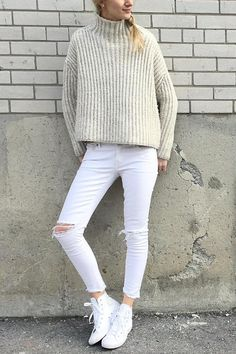 Amara of Lace and Braids sports our white distressed denim with a chunky-knit cream scarf and classic white sneakers for a sporty chic monochromatic street style | Banana Republic