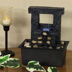 Sunnydaze Falling Stream Tabletop Fountain w/ LED Lights Add contemporary flare and Zen style to any space in your home with a stunning tabletop fountain. The Falling Stream Tabletop Fountain is designed to resemble stone, but made with a durable polyresin material that is painted black with white speckles. This neutral-toned fountain mixes water and earth elements to give you ultimate relaxation. Relax to the flowing water sounds as water falls from the spouts in the top of the water…
