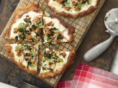 Low-fat cottage cheese stands in for ricotta in these quick weeknight white pizzas. Ours are topped with turkey sausage, spinach, mushrooms and basil, but feel free to experiment with other vegetables and lean meats.