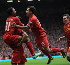 The Liverpool players show their delight after going 3-0 up against Arsenal. #LFC