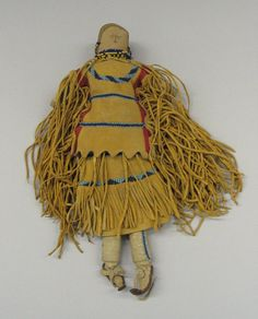 Apache, White Mountain (Native American). Stuffed Doll with Two-piece Dress, Boots and Beaded Barette, late 19th century. Cloth, hide, beads