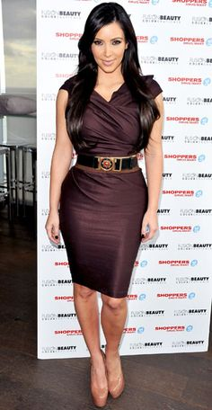 Kim Kardashian makes the most of her famous shape with formfitting, waist-centric pieces.