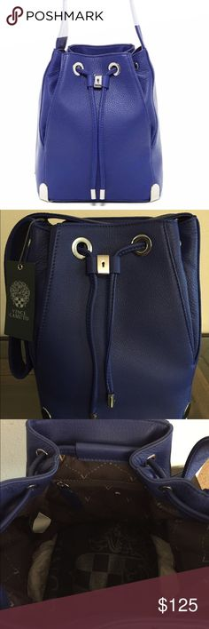 "Vince Camuto Janet leather Drawstring handbag - Single shoulder strap - Drawstring closure - Exterior features hardware accents and pebbled leather construction - Interior includes 1 wall zip pocket - Dust bag included - Approx. 10"" H x 10"" W x 6"" D - Approx. 11"" strap drop Color: Lapis blue Vince Camuto Bags"