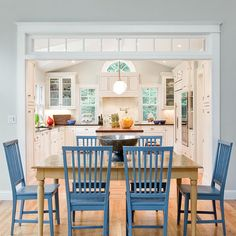 Kitchen Table, wooden table, colored chairs
