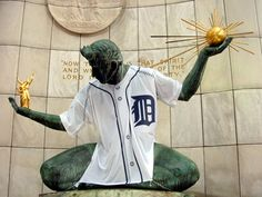 The Spirit of Detroit is a city monument with a large bronze statue created by Marshall Fredericks and located at the Coleman A. Young Municipal Center on Woodward Avenue in Detroit, Michigan, USA.