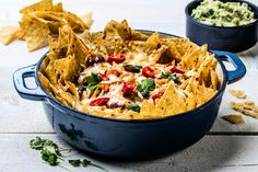 The meat has been replaced by beans and root veggies in this flavour-packed nachos recipe. Topped with lovely cheese, creamy guacamole and a twist of lime, the nachos are great for any festive occasion - quick and easy to make in large quantities. Nacho Chips, Root Veggies, Kidney Beans, Winter Food, Guacamole, Cheddar, Pasta Salad, Feta, Sweet Potato