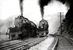 Two of Baltimore and Ohios biggest steam locomotives EM1 class 2-8-8-4s 7610 and 7620 claw their way around Salt Lick Curve near Terra Alta, W.Va.,