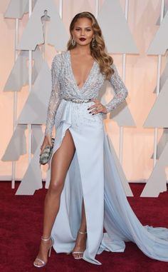 Chrissy Teigen in a pale blue deep-v embellished high slit Zuhair Murad gown.