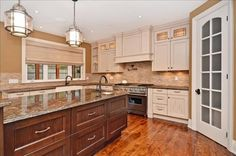 Now that's a kitchen! Carrie Underwood and Mike Fisher have listed their 11-acre, five-bedroom, five-bathroom Canadian estate. For more information and photos, visit the website of real estate agent Paul Rushforth. Visit GACTV.com for the full gallery.