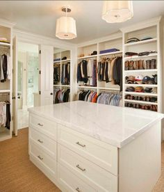 Stunning walk-in closet with floor to ceiling shelving and clothes rails and a center closet island. The ceiling height cabinetry is finished with crown molding. The central closet island with drawers Master Closet Design, Walk In Closet Design, Master Bedroom Closet, Closet Designs, Master Closet Layout, Master Suite, Closet Island, Closet Remodel, Luxury Closet