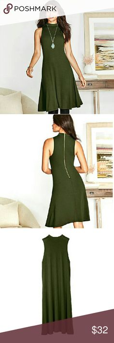 """Green Tunic w Goldtone Rear Zipper Simple yet gorgeous! A chic green tunic with exposed goldtone zipper cascading down the back. Long enough to wear as a dress or pair it with leggings and wear it as a cute top!   FEATURES Sleeveless Round collar High back (to neckline) Exposed goldtone zipper at center back Center of back to hem: 36 1/2"""" for all sizes  ?MATERIALS 95% Rayon, 5% Spandex  Available in S   6-8 M  10-12 L   14-16 XL 18 Signature Collection Tops Tunics"""