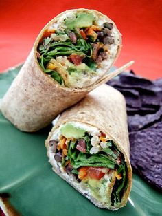 Vegan black bean & Barley Wraps  1 pkg. (8 to 12) medium whole wheat tortillas  1 recipe cashew cheese spread (recipe follows)  1 cup pearled barley, cooked  1 can (15 oz.) black beans  1/2 bunch cilantro, finely chopped  2 Roma tomatoes, finely diced  1 large carrot, shredded  1 to 2 avocados, pitted, peeled and diced  1 bunch spinach, washed and stemmed
