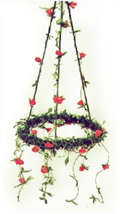 """Modern Finnish paper chandelier, design """"Rose Chandelier"""" (Ruusukruunu). Made of traditional Finnish artist´s paper thread. Material kit from the arts & crafts shop Taito Pirkanmaa."""
