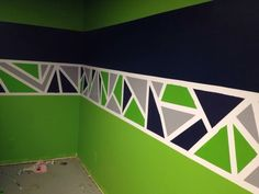 Painted geometric triangle border in Seattle Seahawks color scheme Room Paint Designs, Bedroom Wall Designs, Bedroom Ideas, Diy Wall Painting, House Painting, Seahawks Colors, Geometric Wall Paint, Boy Room Paint, Room Decor