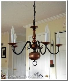 Love the scrollworkn do without the crystals light my world brass chandelier redo using rust oleum expresso brown gloss spray paint and worn penny metallic aloadofball