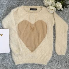 Fuzzy Zara Heart Sweater Super cute, soft and trendy fuzzy heart sweater from Zara! Size Medium. This is definitely a cropped sweater with cropped sleeves. I'd say it runs small and fits more like an XS/S. Excellent condition! No stains or signs of wear. So cozy! No trades. Zara Sweaters Crew & Scoop Necks