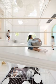 Architects design the playground house of this family's dreams with slides and nets for their energetic children. #modern #homes #homedesign